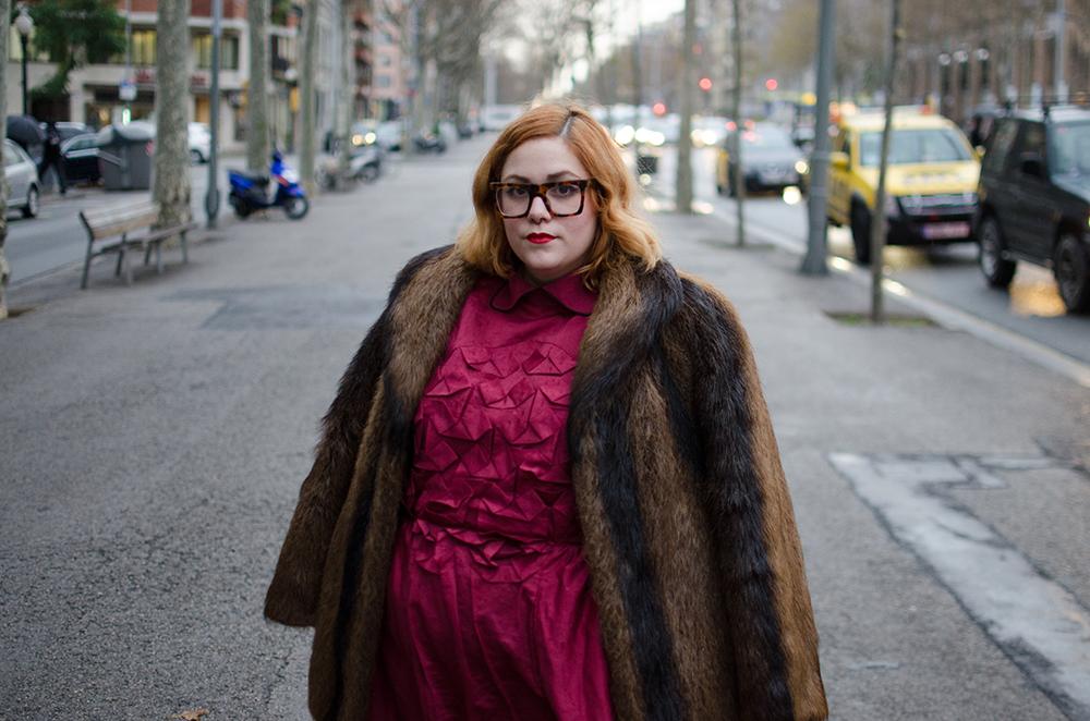Fur coat and burgundy dress